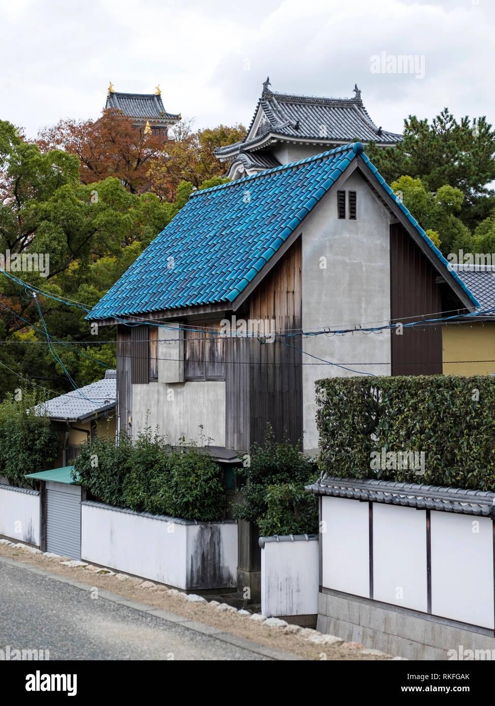 Traditional Japanese house with enameled blue roof tiles, Okayama, Japan - Stock Image