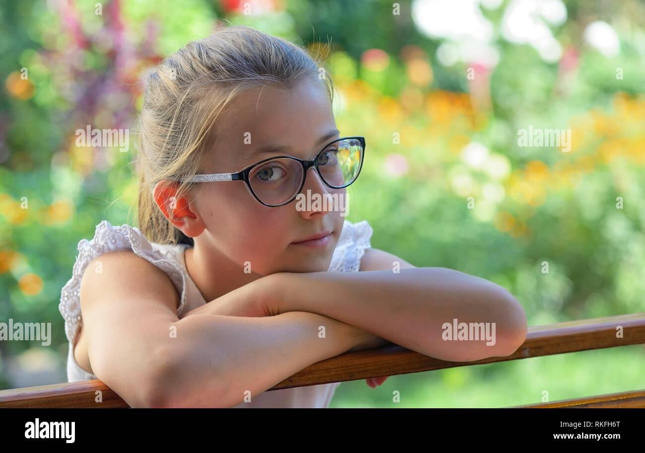 Thoughtful little girl outdoor. - Stock Image