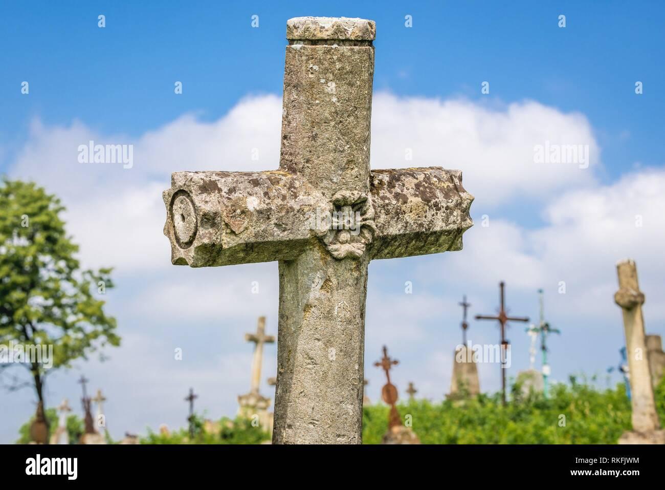 Abandoned cemetery near ruined castle in former Chervonohorod village in Zalischyky region, Ternopil Province, Ukraine. - Stock Image