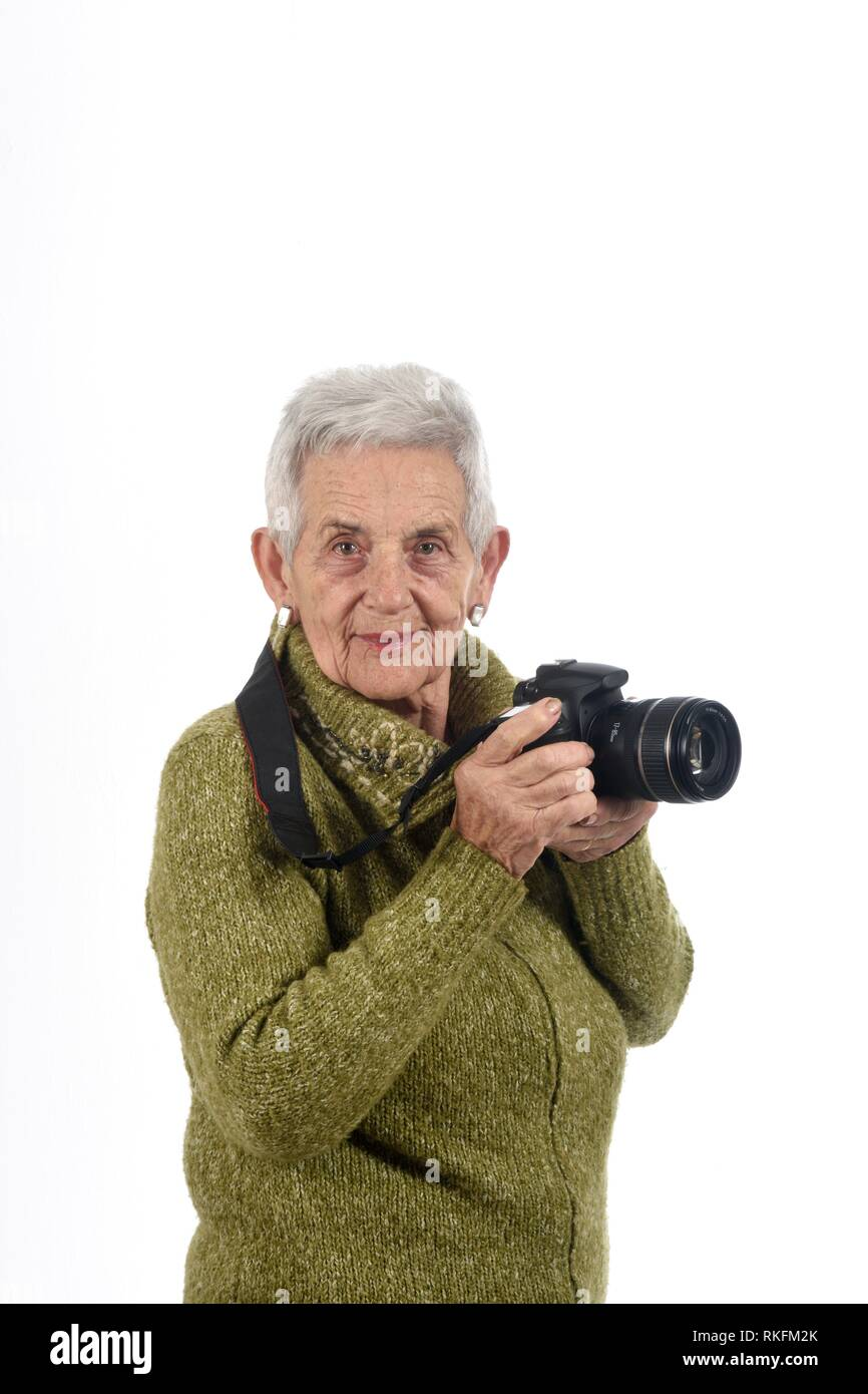 older woman with a SLR camera. - Stock Image