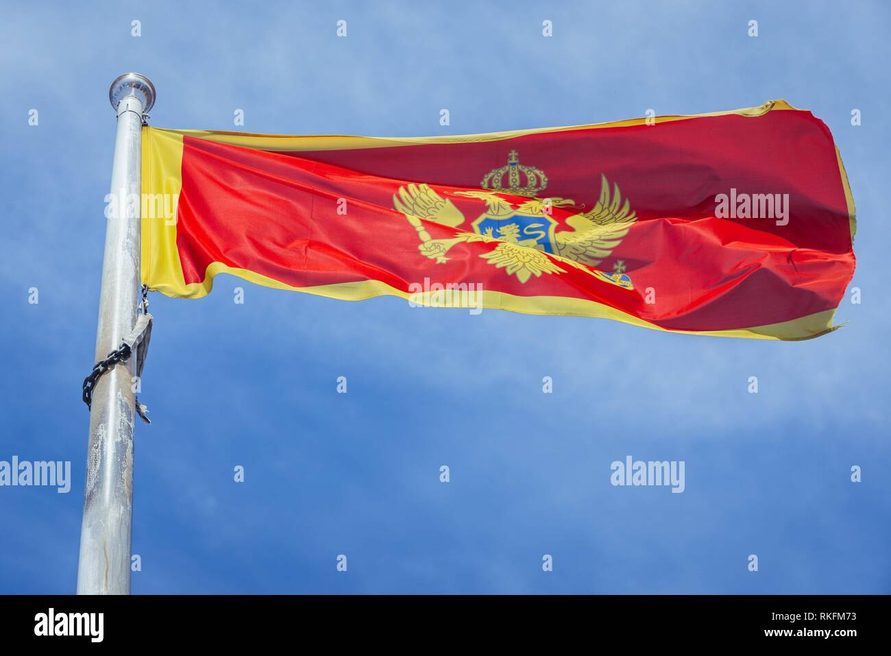 Montenegrin flag in Citadel on the Old Town of Budva city on the Adriatic Sea coast in Montenegro. Stock Photo