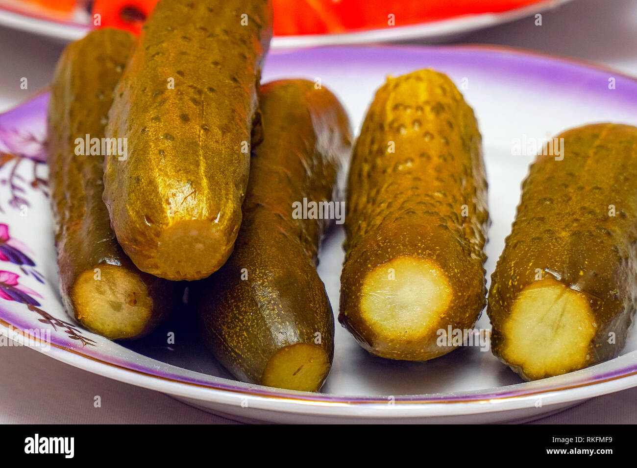 Salted pickled cucumbers on a plate Stock Photo