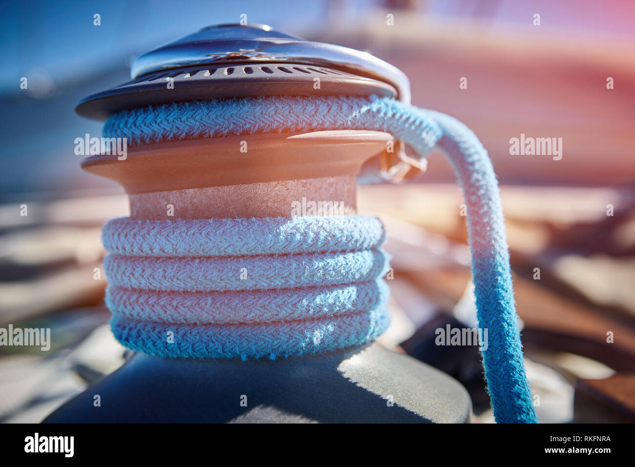 sailing ropes on a yacht close-up. line used to control the angle of the mainsail to the wind - Stock Image