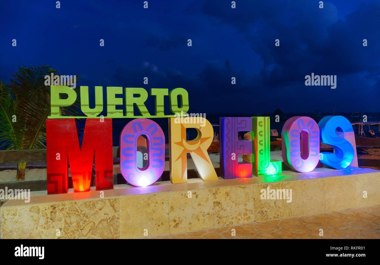 Puerto Morelos sunset word sign in Riviera Maya of Mayan Mexico. - Stock Image