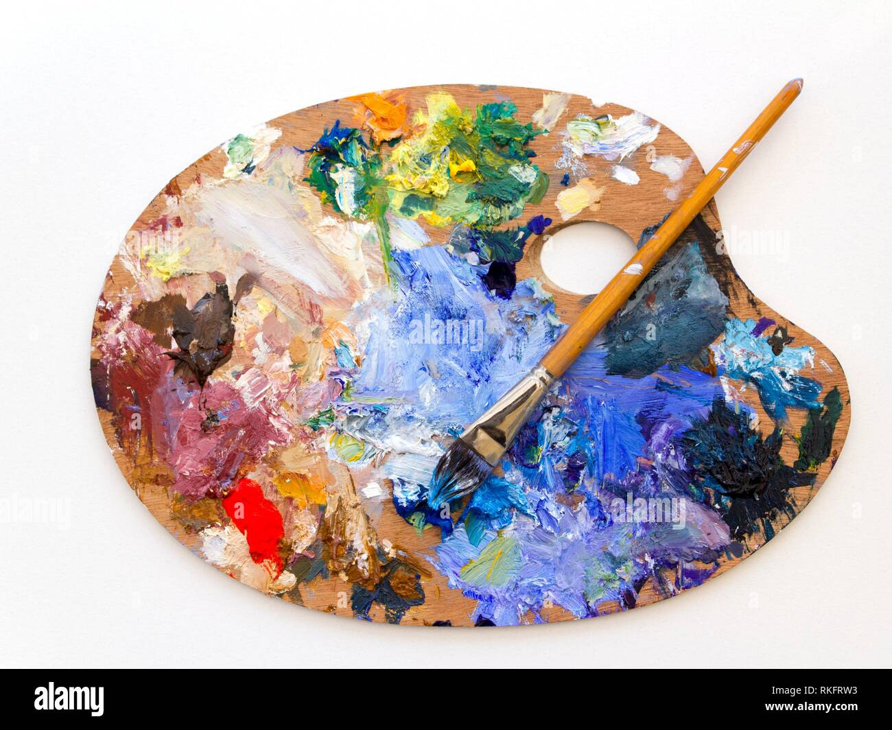 Colourful Artists Oil Paint Palette And Brushes Close Up On