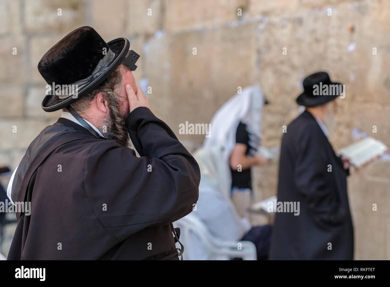 Jerusalem, Israel - November 20, 2018: Religious orthodox jew praying at the Western wall in Jerusalem - Stock Image