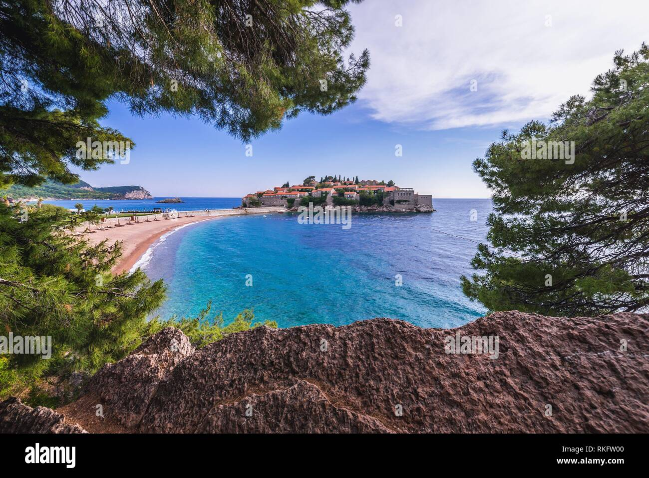 Small island of Sveti Stefan and five star Aman Sveti Stefan hotel resort on the Adriatic coast of Montenegro. - Stock Image