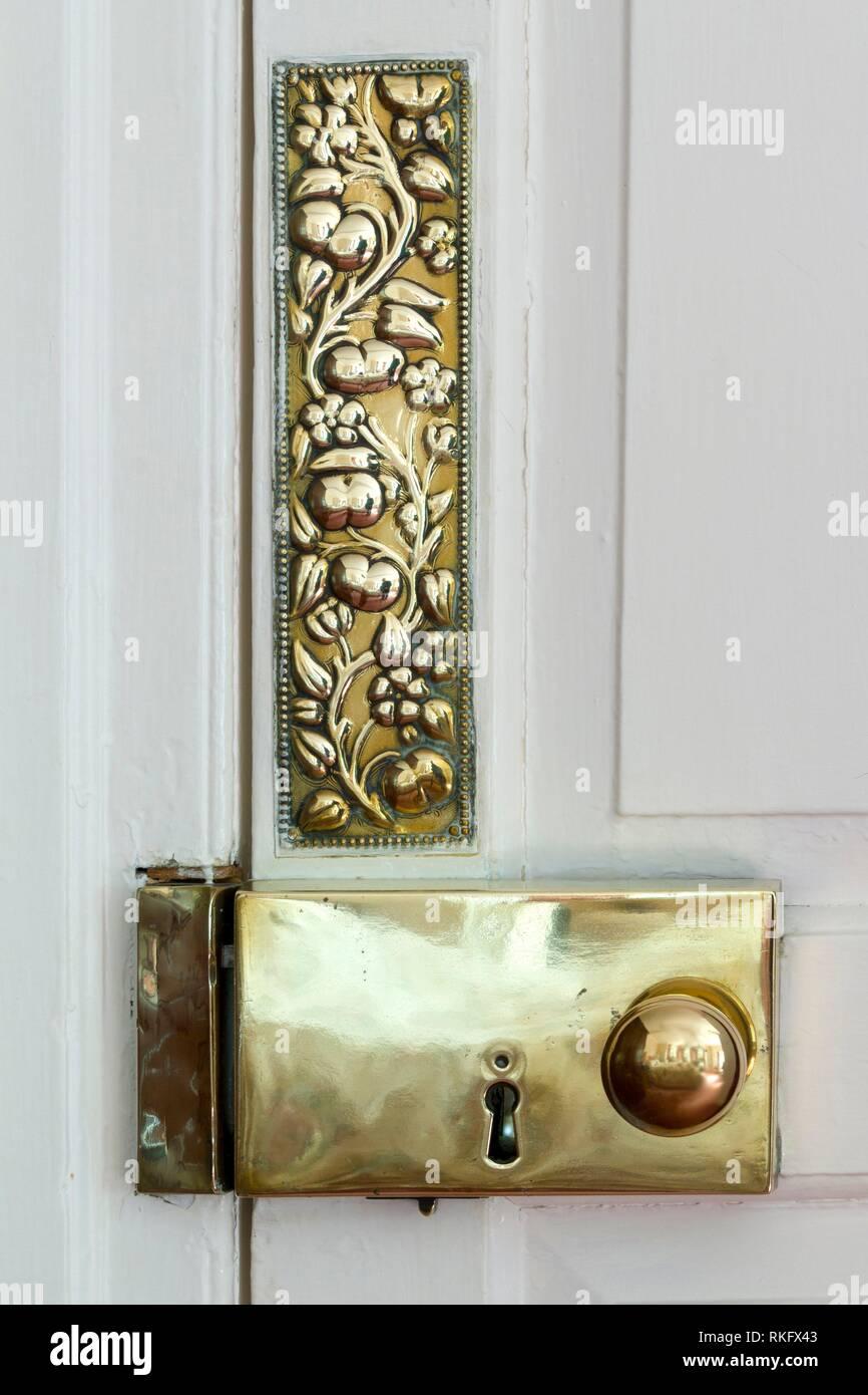 Antique brass door furniture. - Stock Image