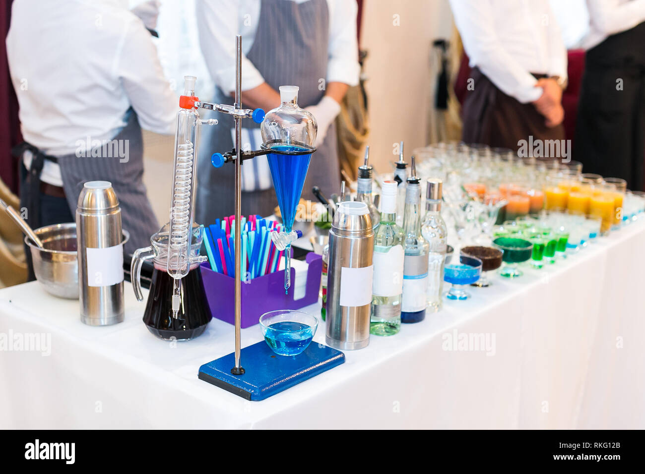 set of test-tubes and various chemical devices for preparations of molecular cocktails. Multi-colored alcoholic molecular beverages for a party. Stock Photo