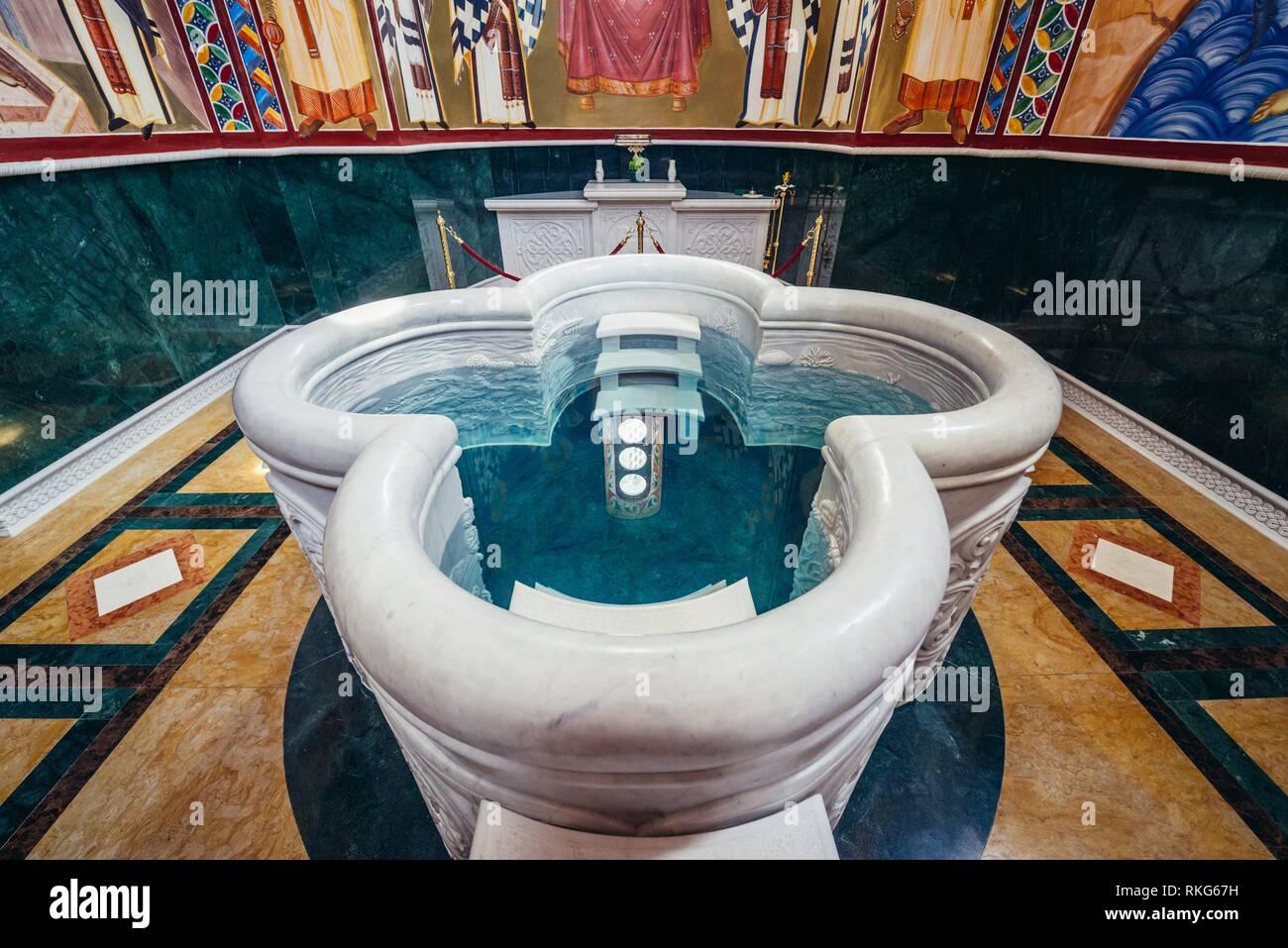 Large baptismal basin in Saint Jovan Vladimir Orthodox temple in Bar coastal town in southern Montenegro. - Stock Image