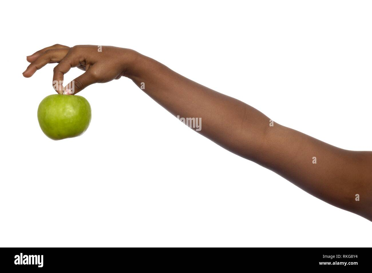 Arm African girl with apple. - Stock Image