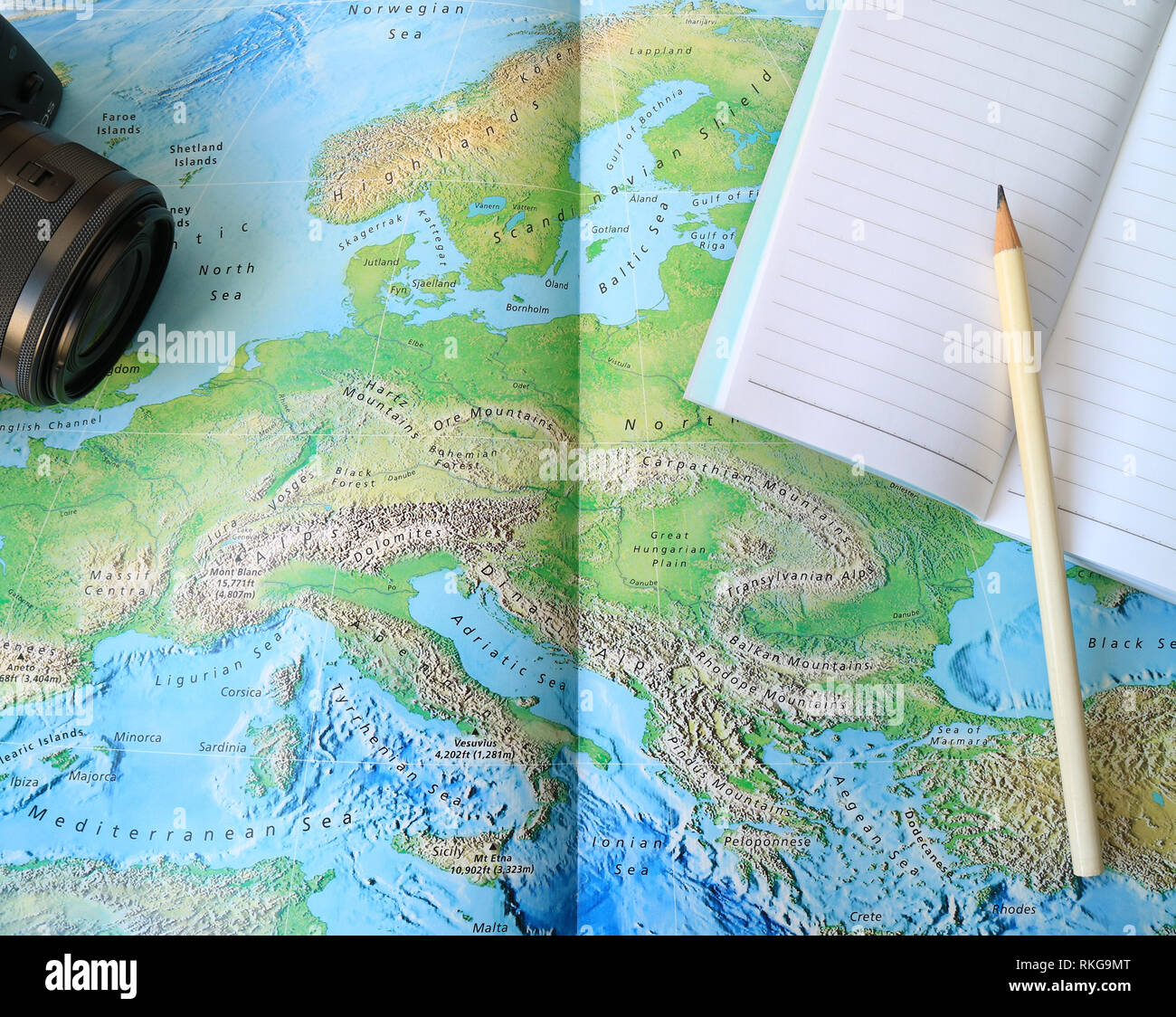 Ibiza On World Map.Black Camera And Lined Notebook With White Pencil On The World Map