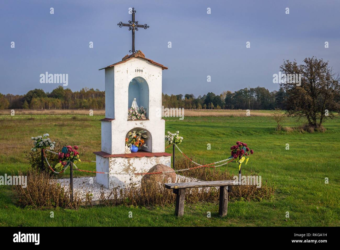 White wayside shrine near Brochow village, Sochaczew County in Masovian Voivodeship of Poland. - Stock Image