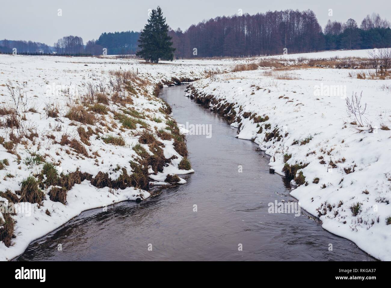 Rudnia river in Soce village on so called The Land of Open Shutters trail, famous for traditional architecture in Podlaskie Voivodeship, Poland. - Stock Image