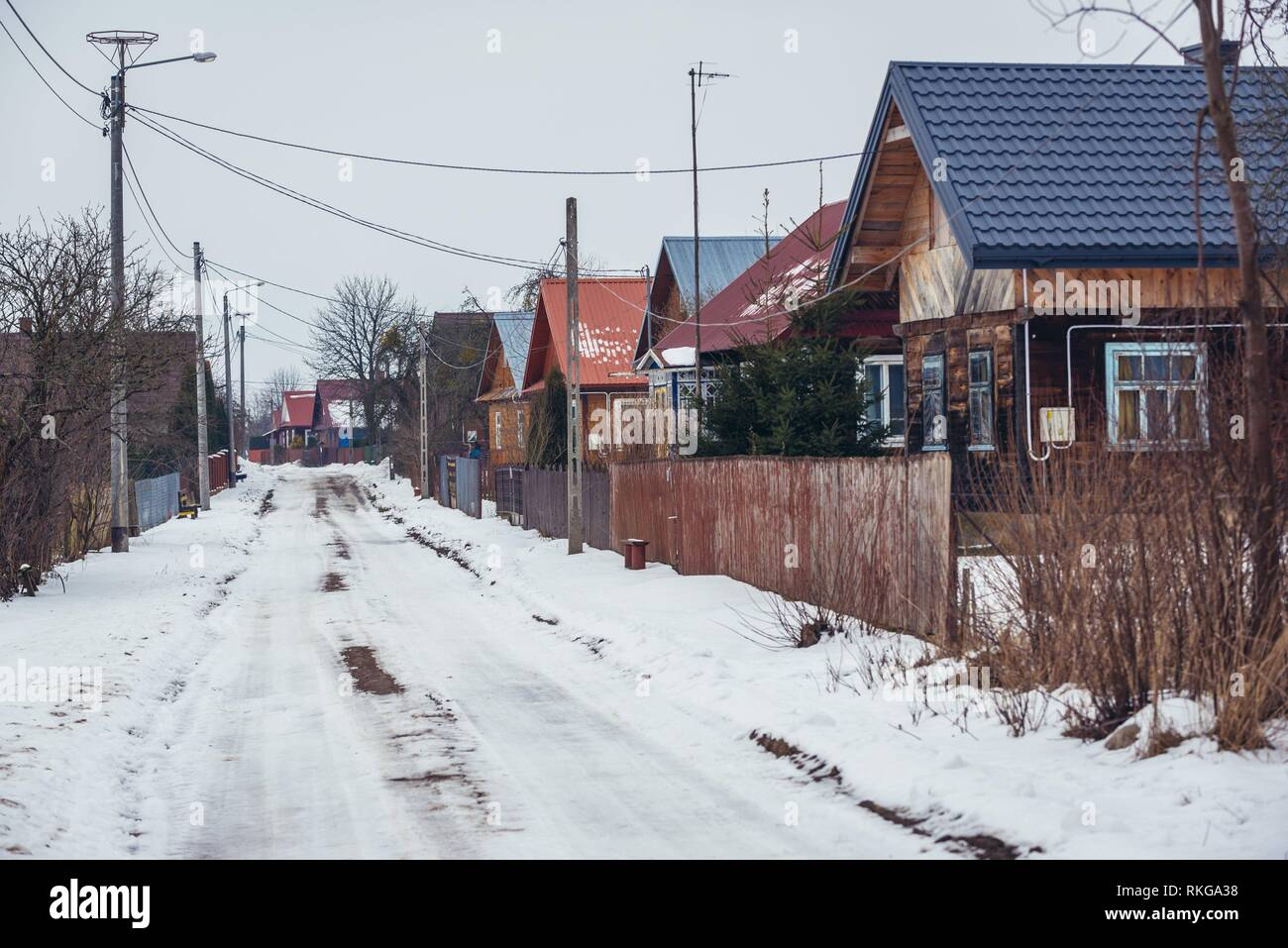 Wooden houses along road in Soce village on so called Land of Open Shutters trail, famous for traditional architecture in Podlaskie Province, Poland. - Stock Image