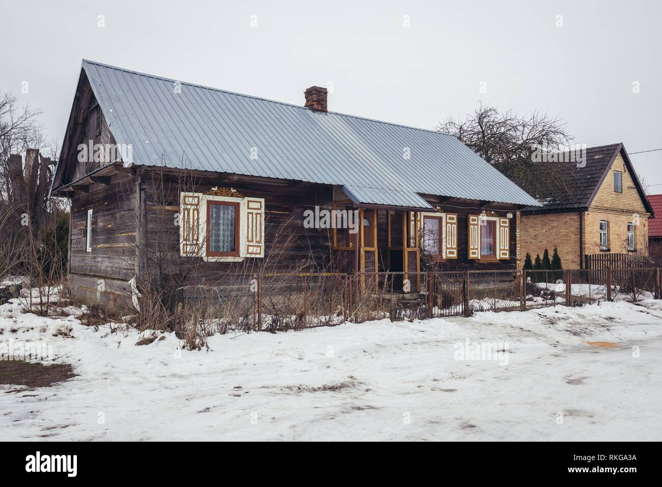 Wooden house in Soce village on so called Land of Open Shutters trail, famous for traditional architecture in Podlaskie Province, Poland. - Stock Image