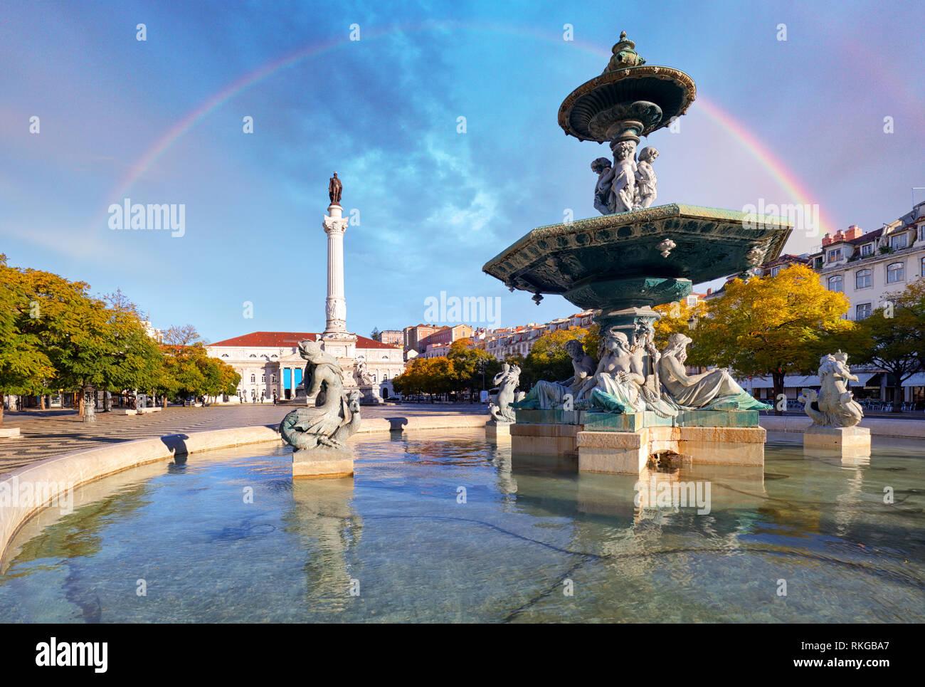 Rainbow over Rossio square in Lisbon Portugal Stock Photo