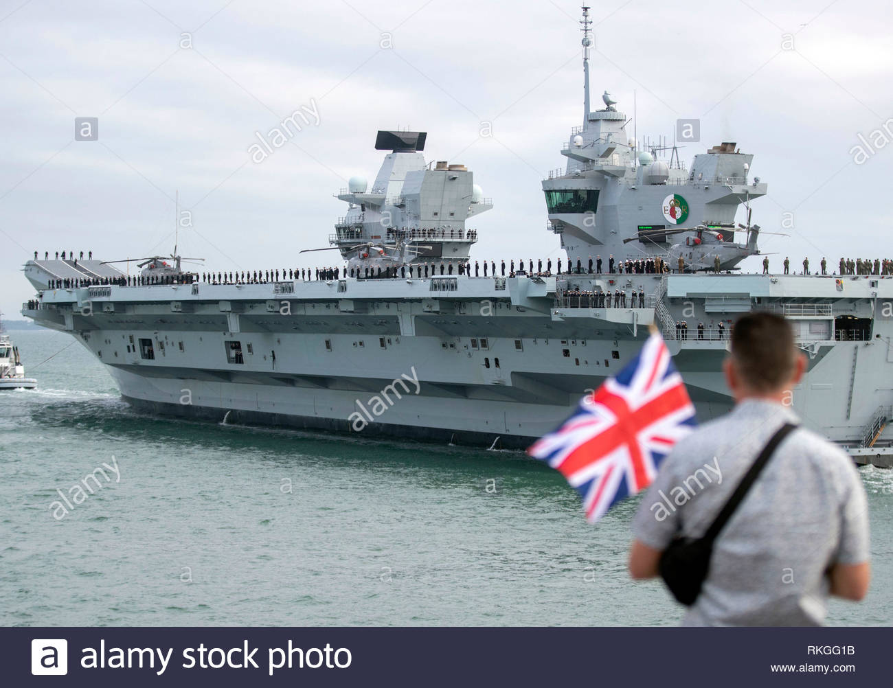 File photo dated 18/3/2018 of HMS Queen Elizabeth leaving Portsmouth Harbour. In a speech at the Royal United Services Institute, Defence Secretary Gavin Williamson said that the carrier, embarked with UK and US F-35 jets, will be deployed on her first operational mission to the Mediterranean, the Middle East and the Pacific region - where Beijing has been involved in a dispute over navigation rights and territorial claims in the South China Sea. - Stock Image