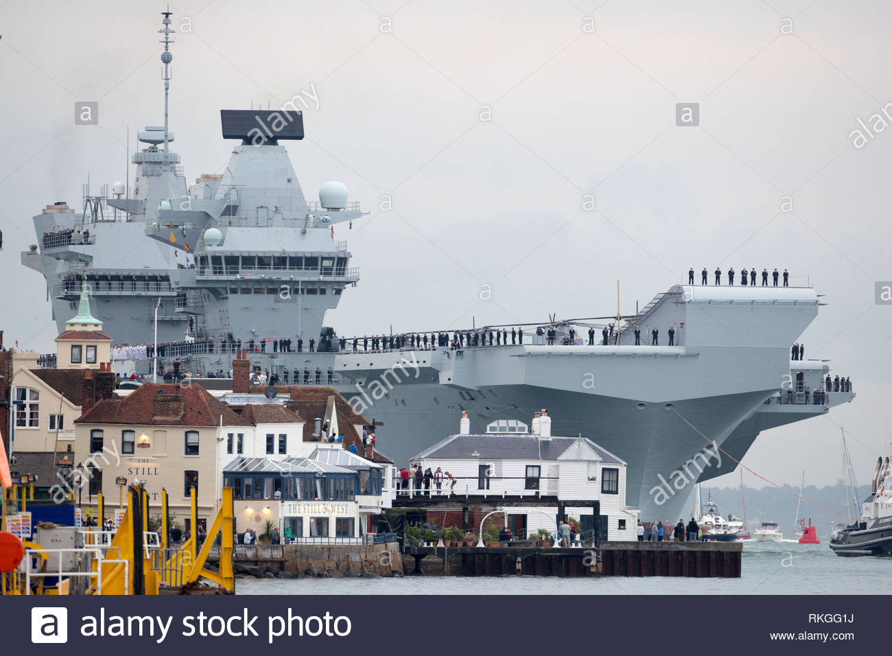 File photo dated 16/8/2017 of HMS Queen Elizabeth arriving at Portsmouth Harbour. In a speech at the Royal United Services Institute, Defence Secretary Gavin Williamson said that the carrier, embarked with UK and US F-35 jets, will be deployed on her first operational mission to the Mediterranean, the Middle East and the Pacific region - where Beijing has been involved in a dispute over navigation rights and territorial claims in the South China Sea. - Stock Image