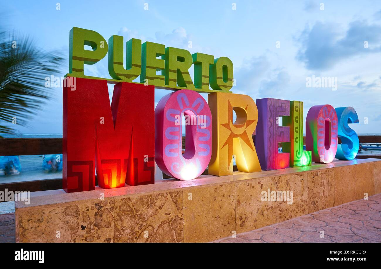 Puerto Morelos word sign in sunset Mayan Riviera Maya of Mexico. - Stock Image