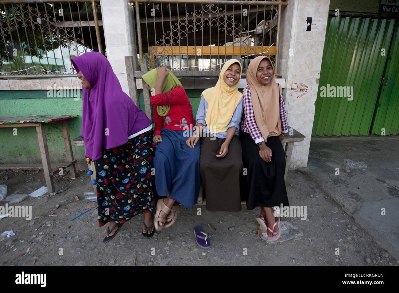 Moslem girls, Laughing Muslim girls wearing hijabs, Dili, East Timor (Timor Leste) - Stock Image