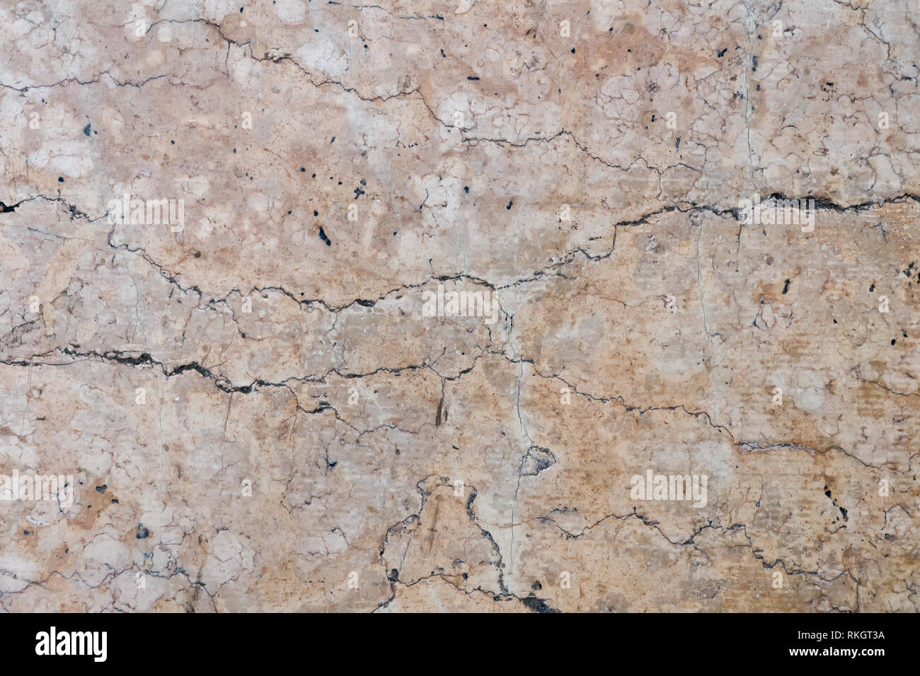 Detailed beige cracked  stone surface, texture of old natural marble Stock Photo