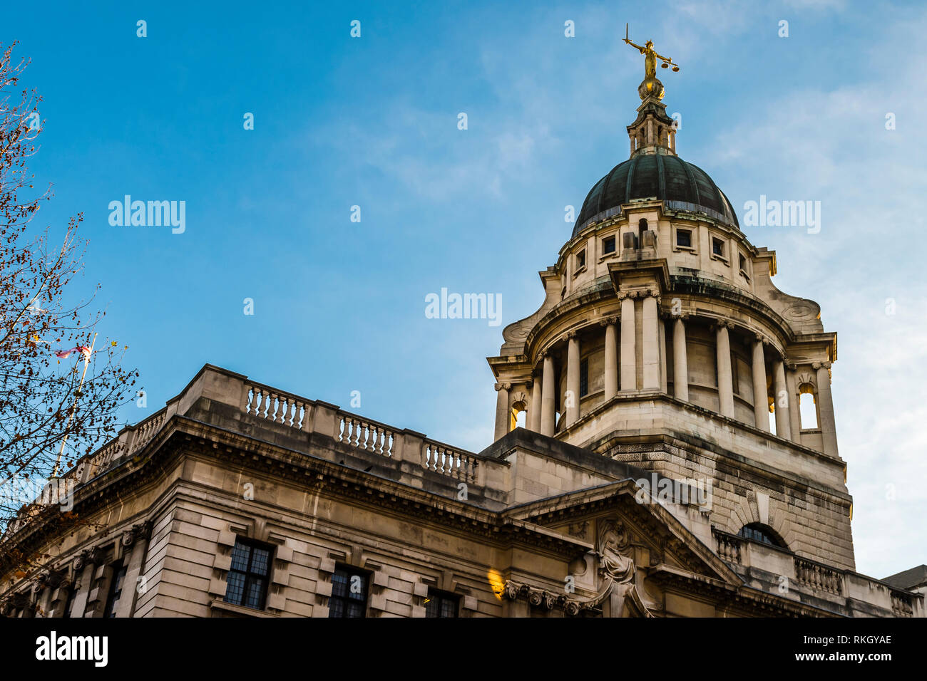 Morning sun over the Central Criminal Court, Old Bailey, London, UK - Stock Image