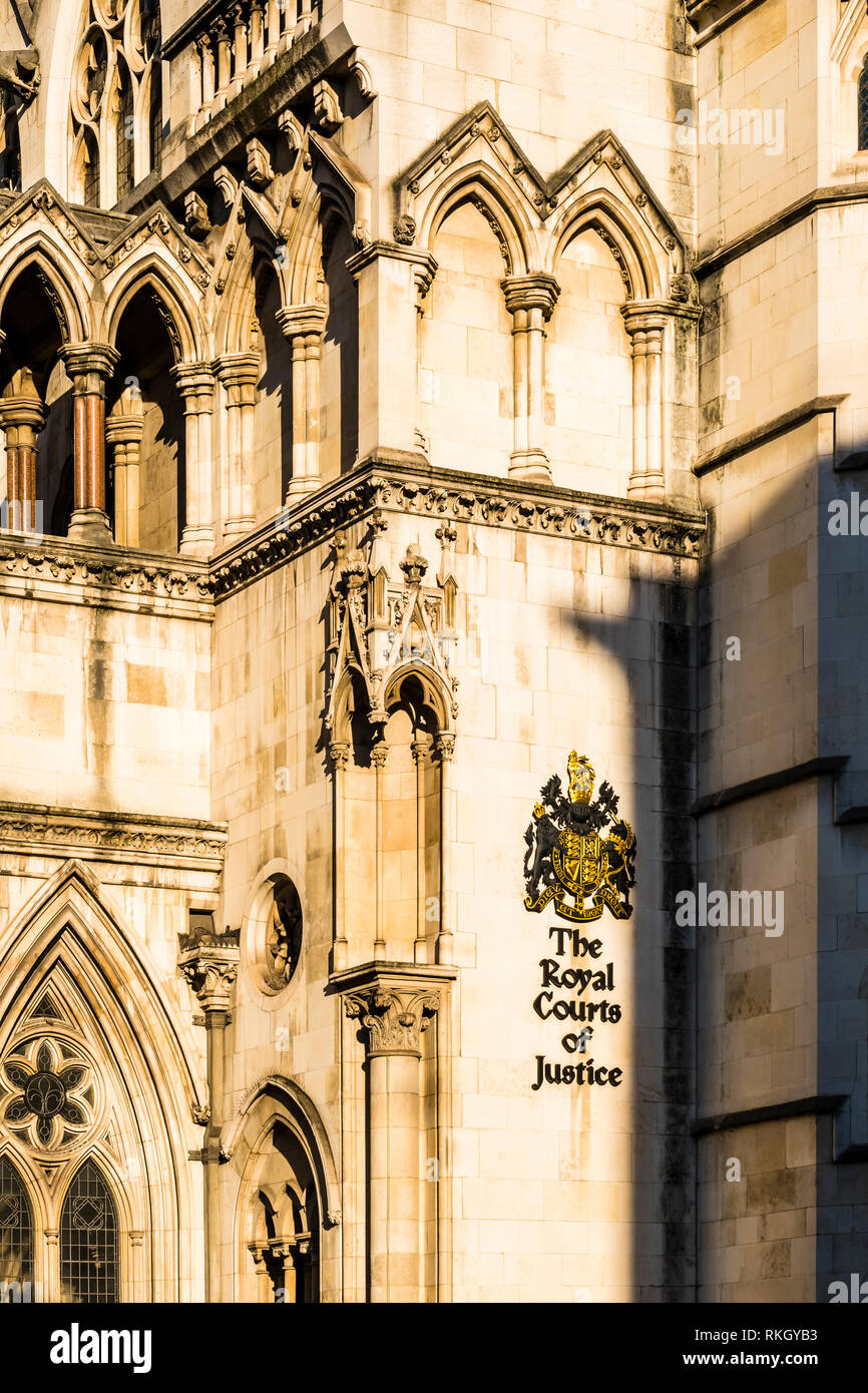 Winter sun on a detail at the Royal Courts of Justice, The Strand, London, UK - Stock Image