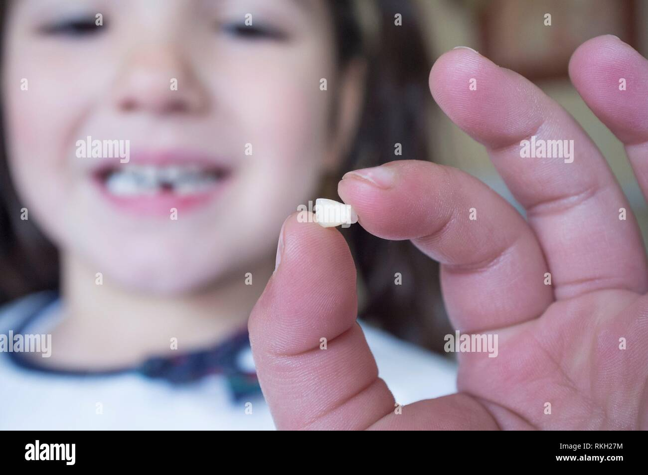 Little 5 years old girl showing her first baby tooth fallen out. Closeup. Stock Photo