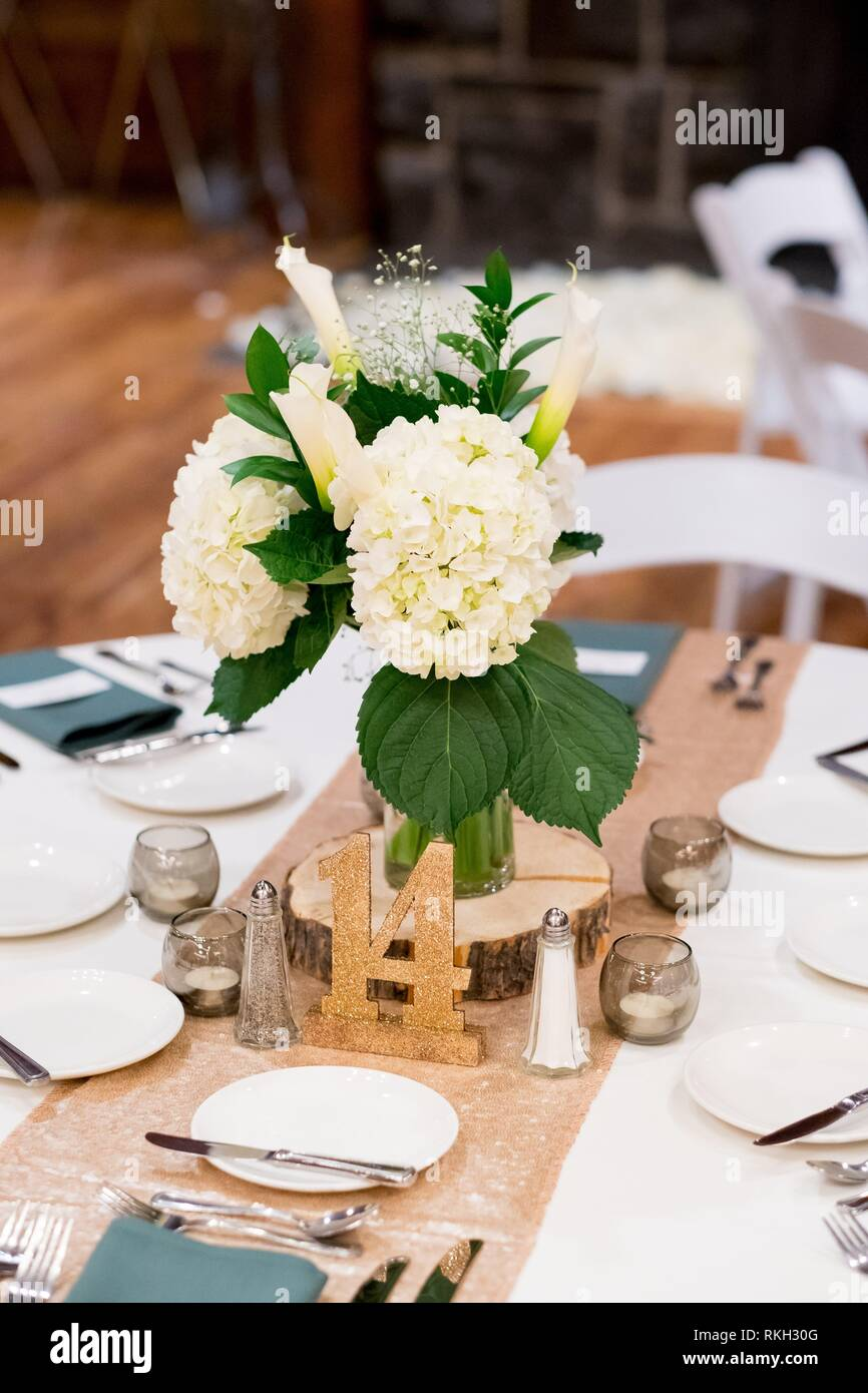 Winter Wedding Reception With Beautiful Flower Centerpieces And Number Seating Assignment Tags In Oregon Stock Photo Alamy
