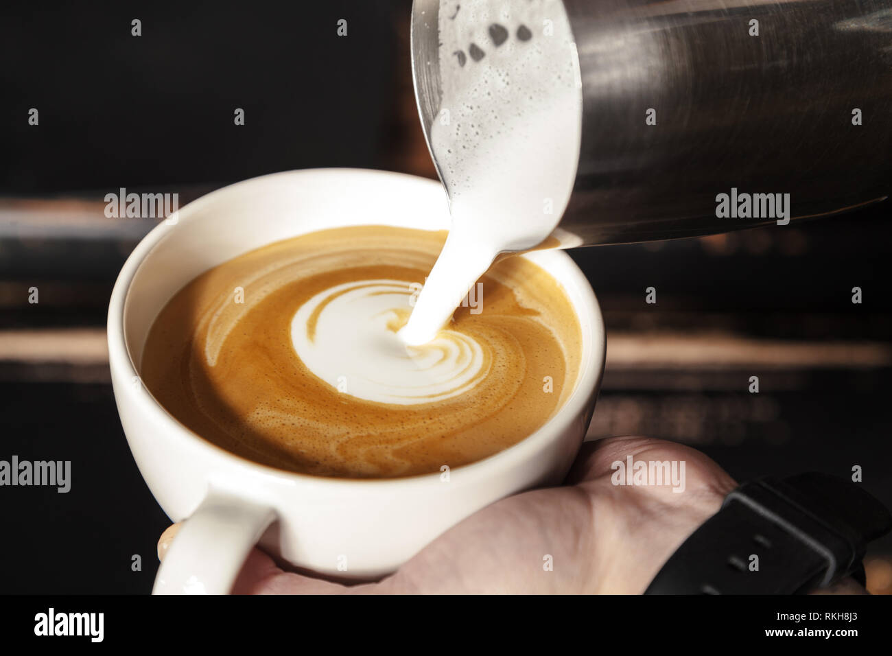 A Professional Barista Holds A Cup Of Coffee Making A Beautiful