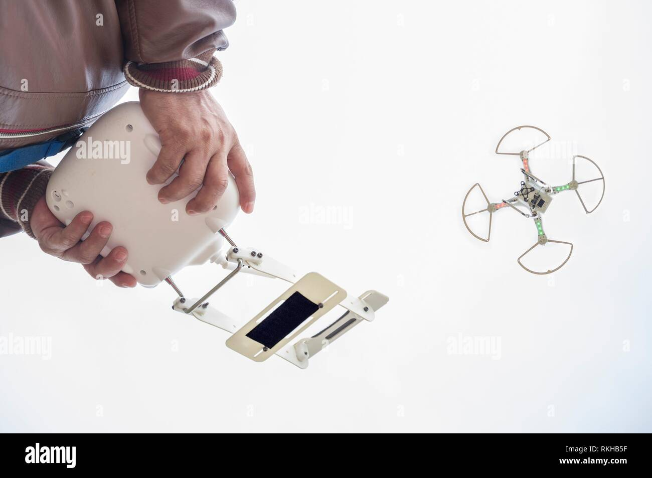 Pilot flying drone with FPV mount empty on remote controller. Aproaching maneuver. - Stock Image