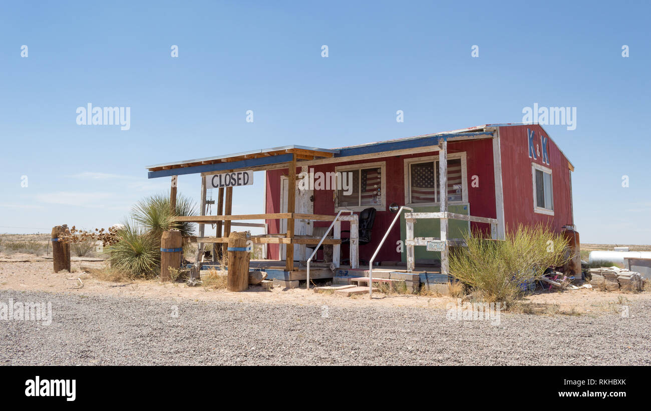 A closed, deserted 'ghost town' shop near Orla, Texas, United States, North America - Stock Image