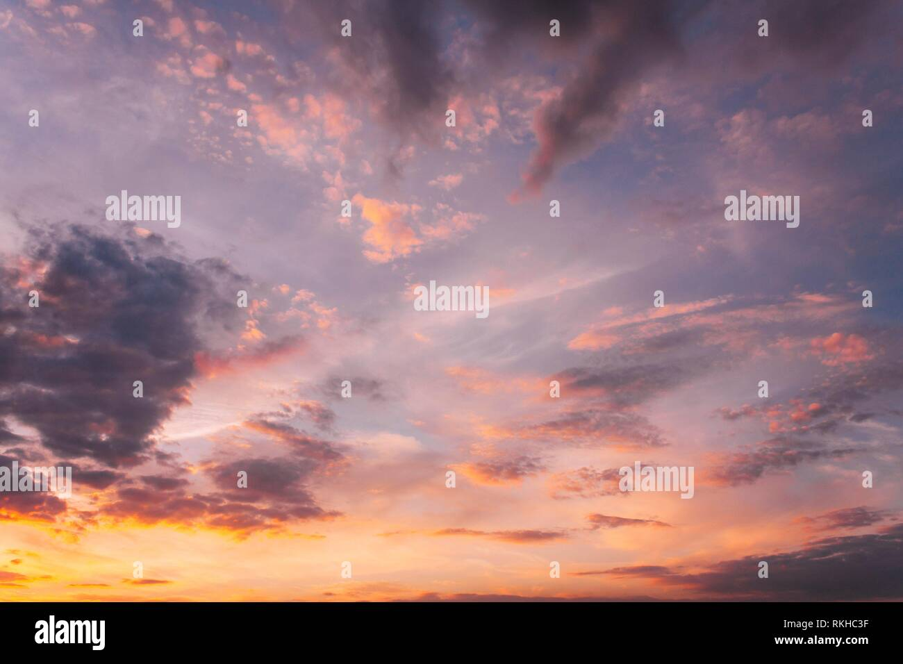 Sunset Sunrise Sky Background. Natural Bright Dramatic Sky In Sunset Dawn Sunrise. Yellow, Magenta, Purple And Pink Colors. - Stock Image