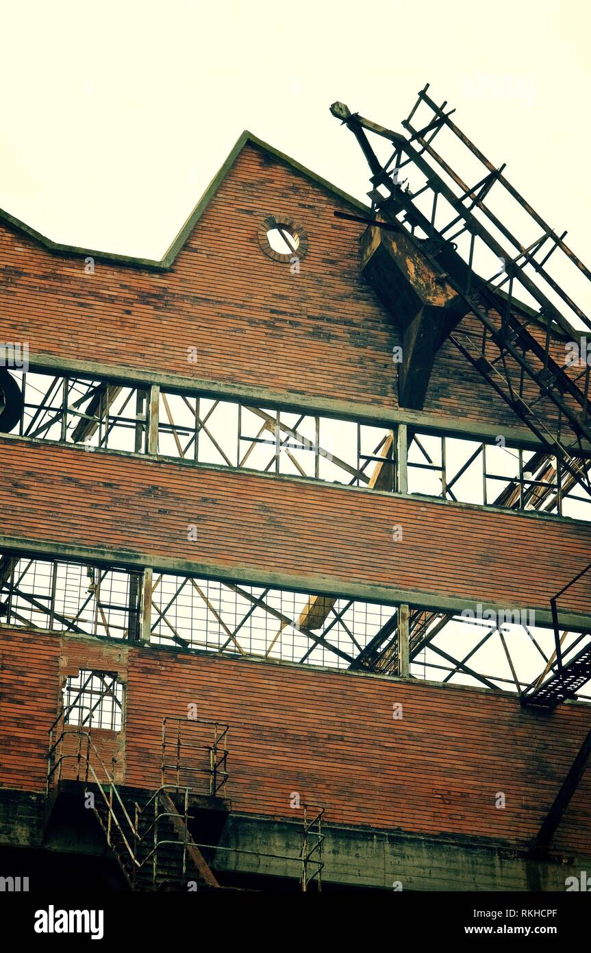 Ruins of an old industrial building into disuse. - Stock Image