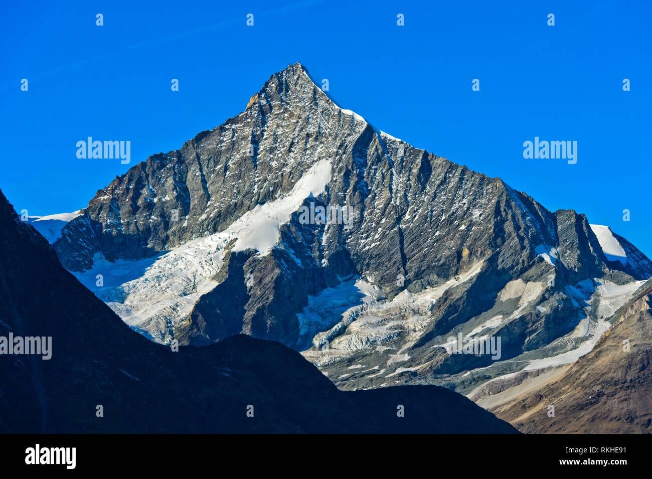 Rugged and symmetrical south face of the peak Weisshorn. Zermatt, Valais, Switzerland. - Stock Image