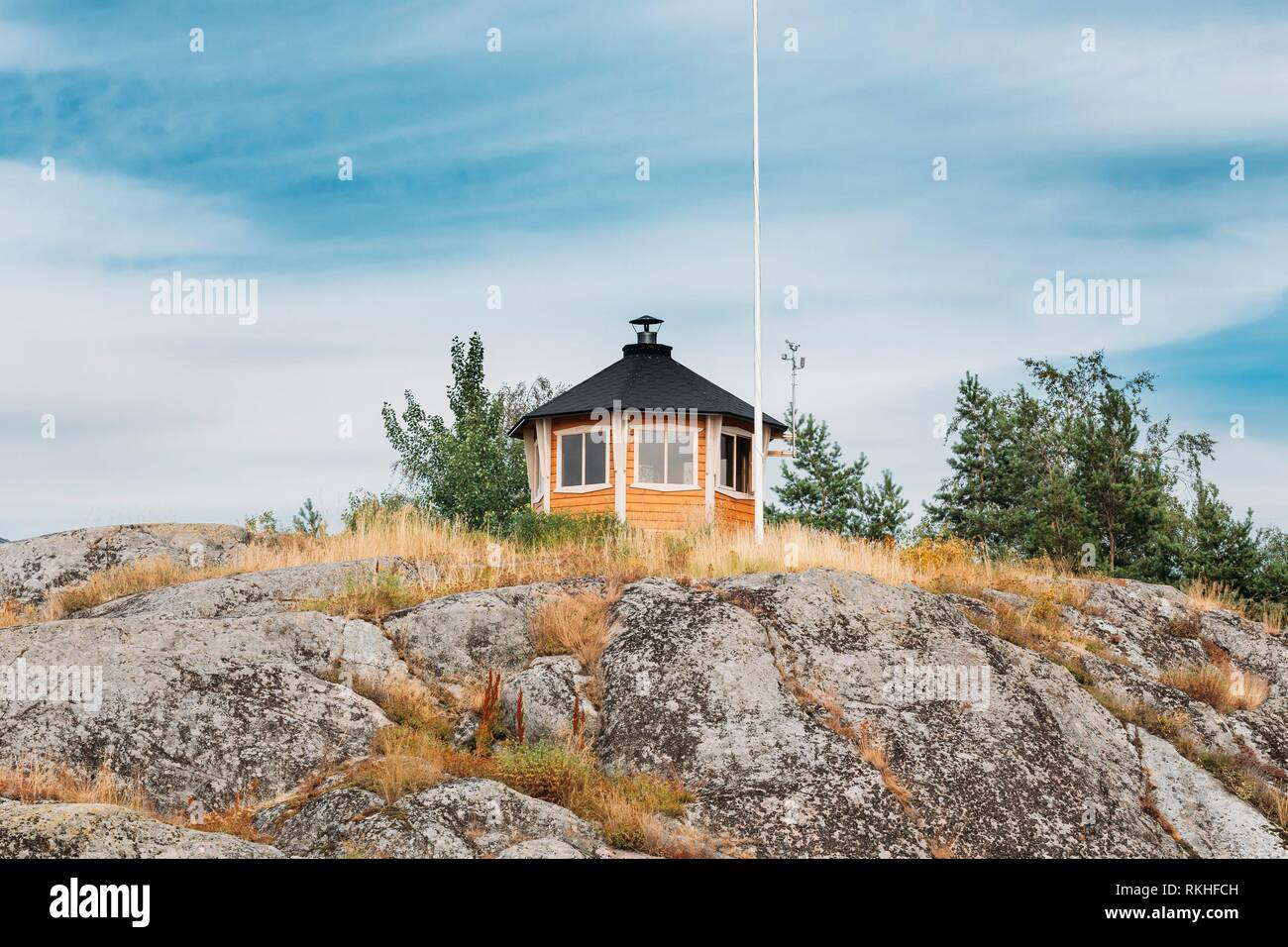 Small Finnish Weather Meteorological Station On Rock In Island in Finland. - Stock Image