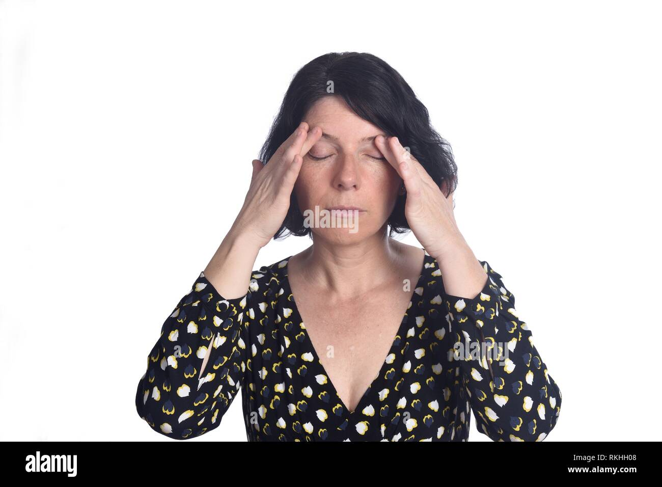 woman with migraine on white. - Stock Image