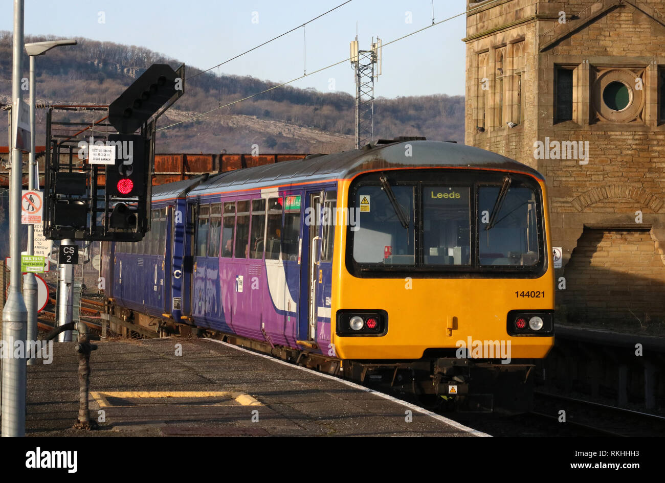 Pacer diesel multiple unit train number 144 021 in Northern livery leaving Carnforth railway station on 11th February 2019. - Stock Image