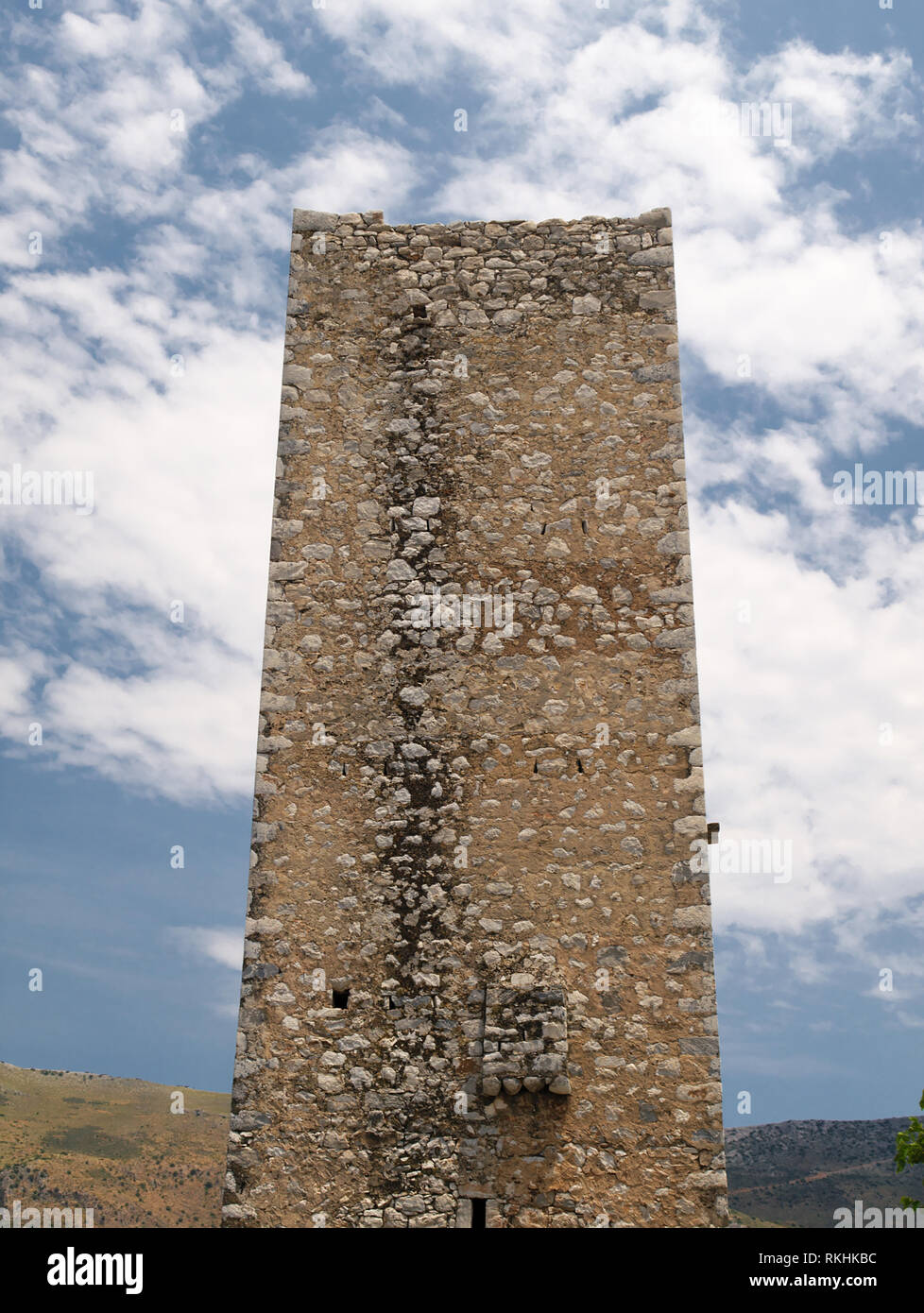 Old stone tower housed in traditional medieval village in Mani, Greece. - Stock Image