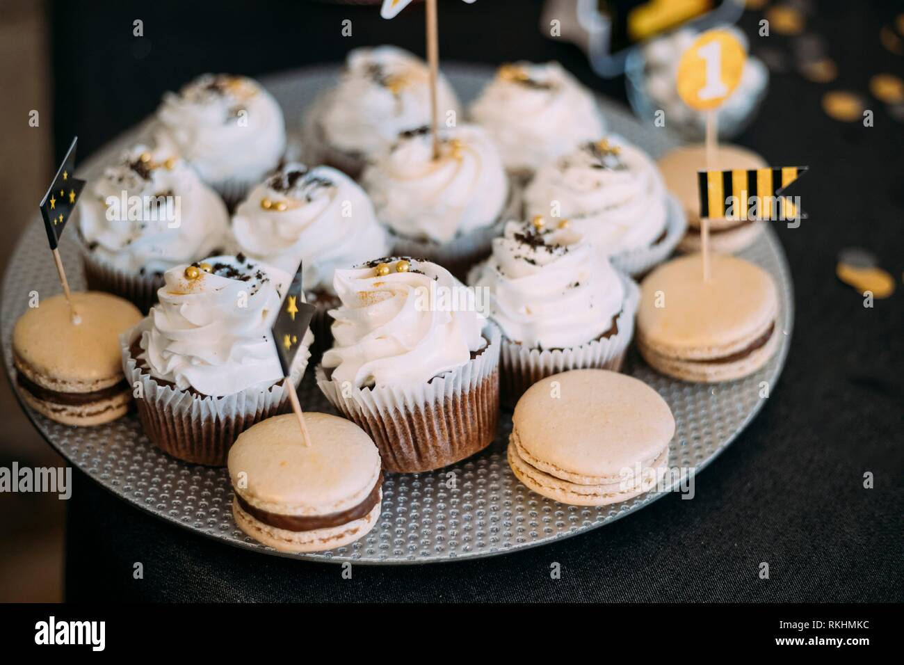 Dessert Sweet Tasty Cupcakes And Macarons In Candy Bar On