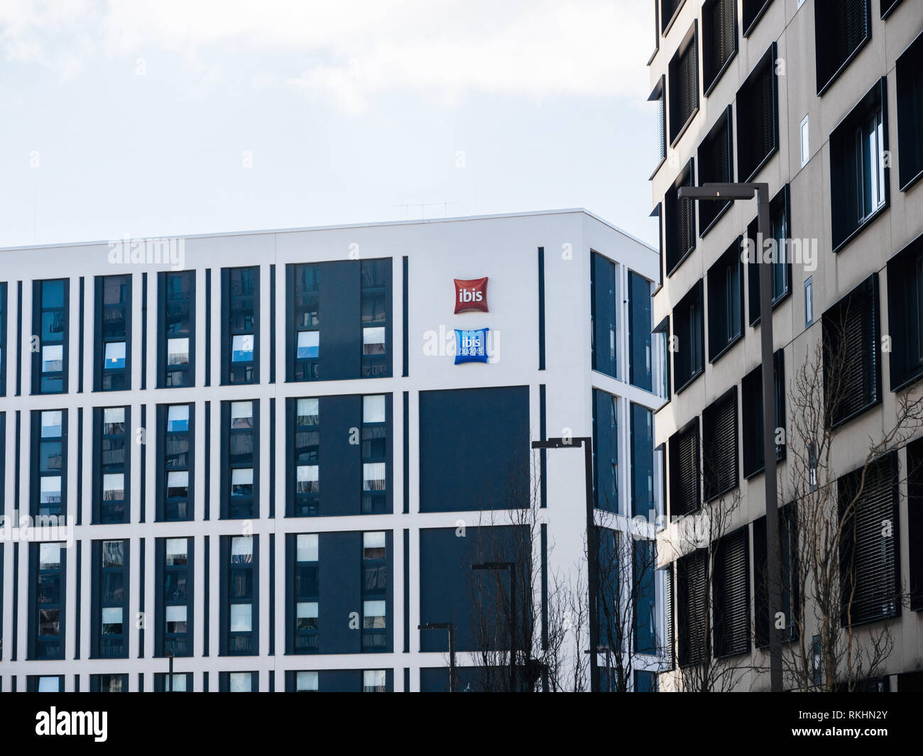 HAMBURG, GERMANY - MAR 20, 2018: Logotype of Ibis and Ibis Budget hotels member of Accor hotel group on the white facade - Stock Image