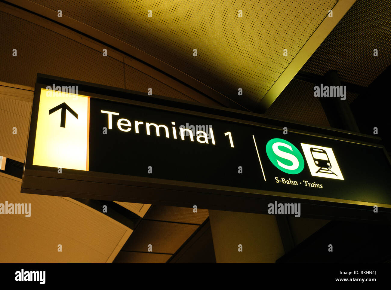HAMBURG, GERMANY - MAR 20, 2018: Airport sign Terminal 1 with access to the train and metro - view from below S-Bahn - Stock Image
