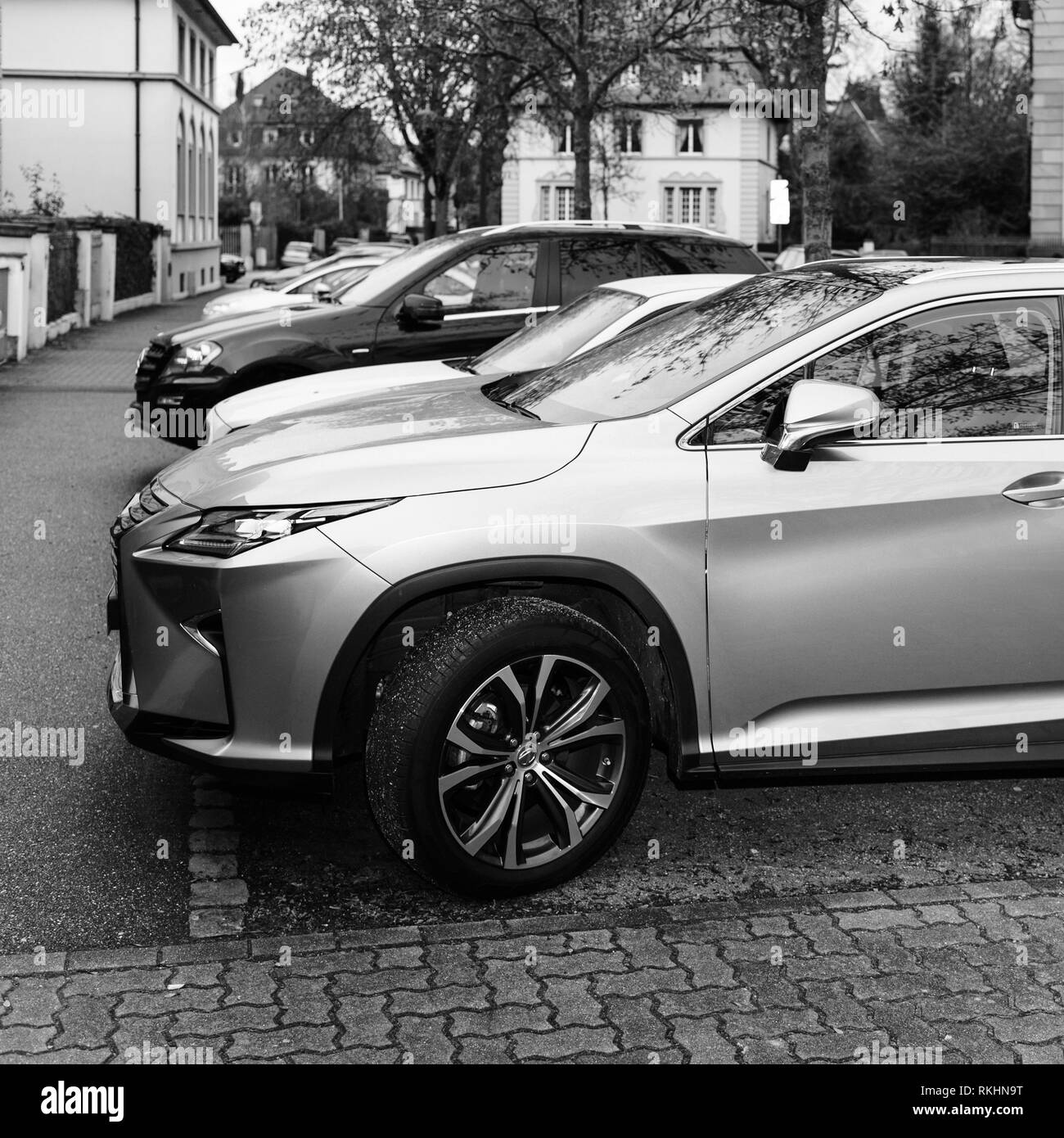 Paris, France - Jan 1, 2018: LEXUS RX 450h luxury silve SUV hybrid car parked on French street square iamge black and white - Stock Image