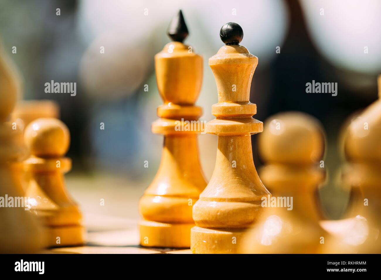 Old Chess Standing On Wooden Chessboard. - Stock Image