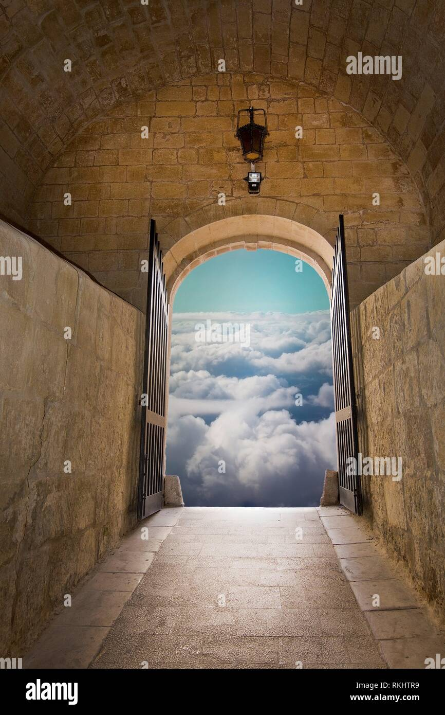 Aerial dreamy cloud landscape, through the gates of medieval fairy tale gates - concept for new dimensions, transition, dream, wishing or hope - Stock Image