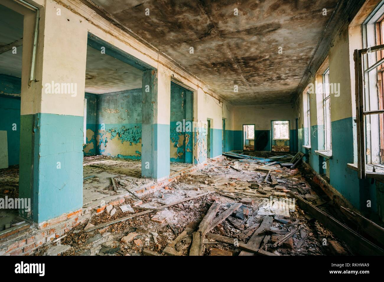 The Ruined Hall Of Abandoned Rural School After Chernobyl Disaster In Evacuation Zone. The Terrible Consequences Of The Nuclear Pollution Twenty Stock Photo