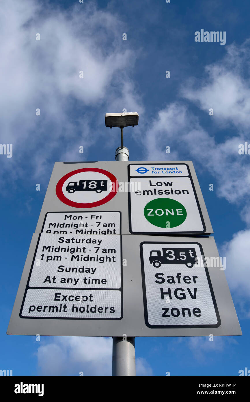 road sign in kingston, surrey, england, denoting a low emissions zone, a safer hgv zone, weight limits and parking restrictions - Stock Image