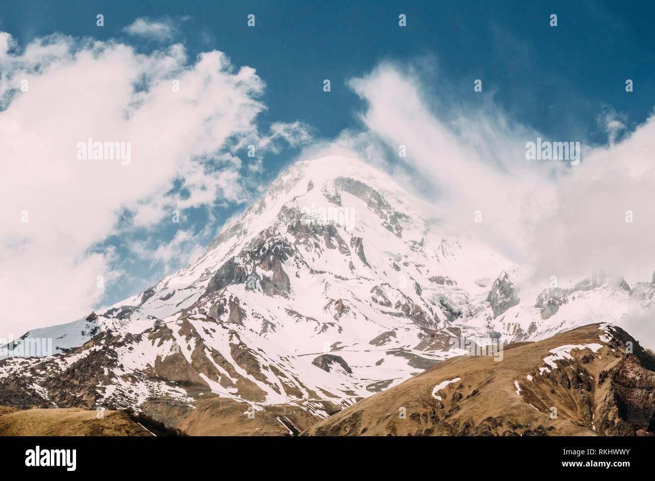Peak Of Mount Kazbek Covered With Snow. Kazbek Is A Stratovolcano And One Of Major Mountains Of Caucasus Located On Border Of Georgia's Kazbegi - Stock Image