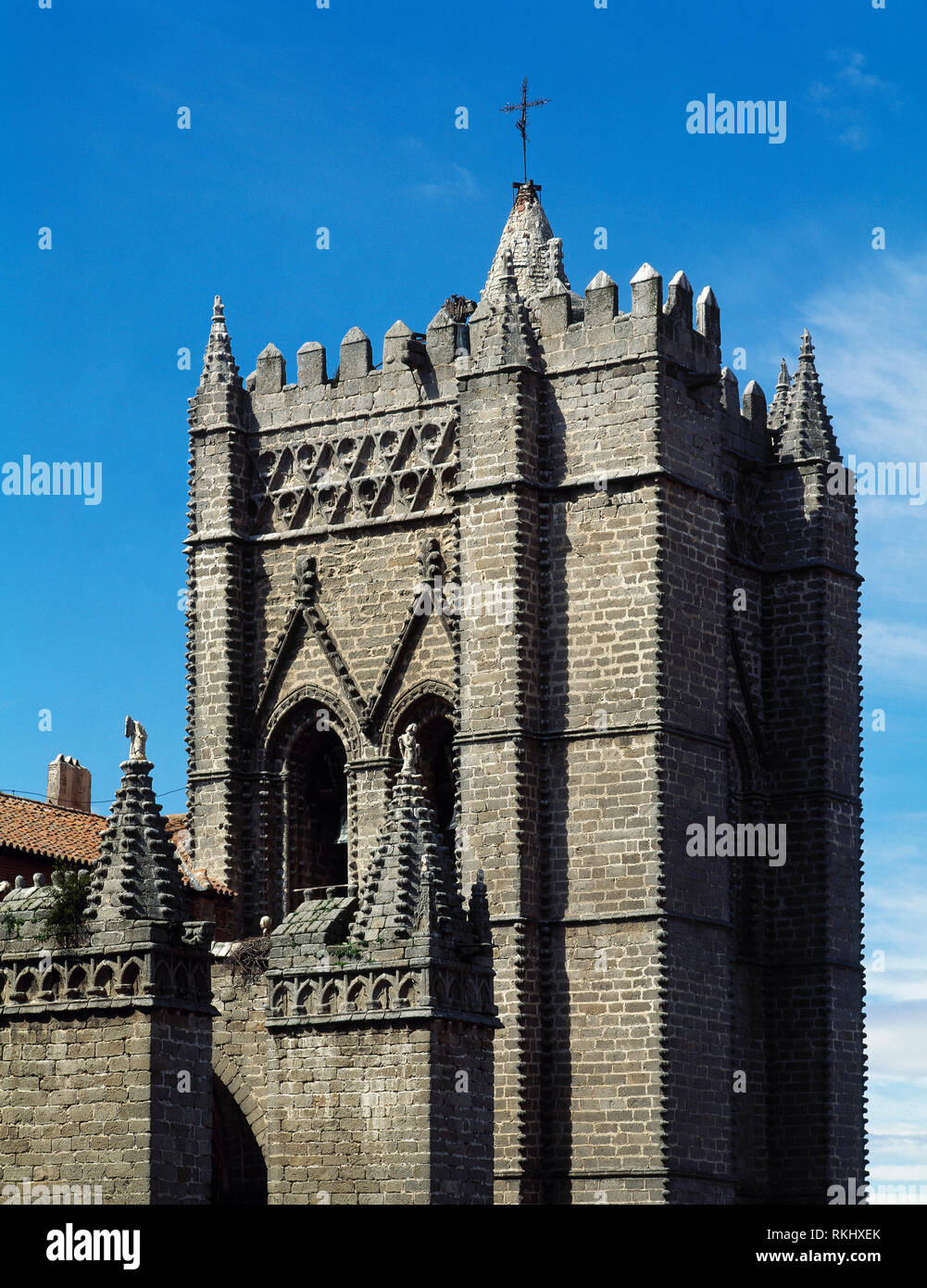 Spain, Castile and Leon, Avila. Cathedral of St. Salvador. Catholic church. Its construction was started in the 12th century in Romanesque style and concluded in the 14th century in Gothic style. Architectural detail. Bell tower. Stock Photo